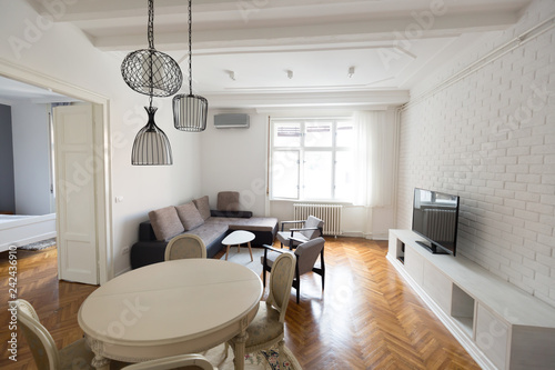 Bright spacious living room with chairs table inside