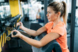Woman working out in gym on machine