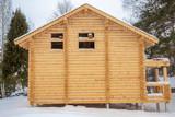 facade of a wooden house under construction - 242449509