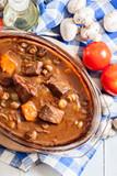 Beef Bourguignon stew in a casserole dish - 242453746