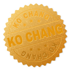 KO CHANG gold stamp award. Vector golden award with KO CHANG label. Text labels are placed between parallel lines and on circle. Golden surface has metallic texture.