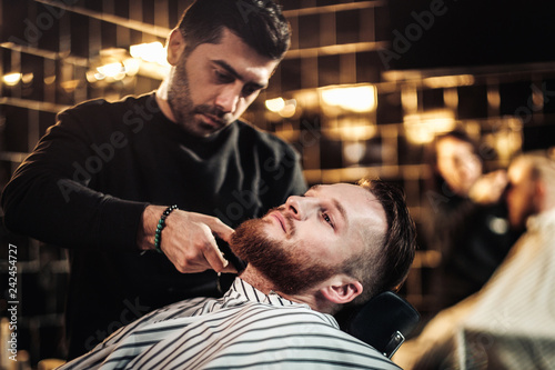 Leinwandbild Motiv Clients in barbershop