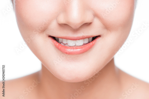 Close up of smile of young asian woman with great healthy white teeth