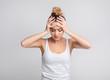 Leinwanddruck Bild - Exhausted woman suffering from unbearable headache over background