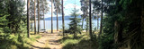 Panoramic image of forest and mountain lake. Tents and car in the wild nature.