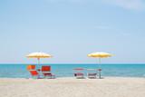 Three Umbrellas and Chairs at sandy beach in Durres, Adriatic Sea shore of Albania - 242466712