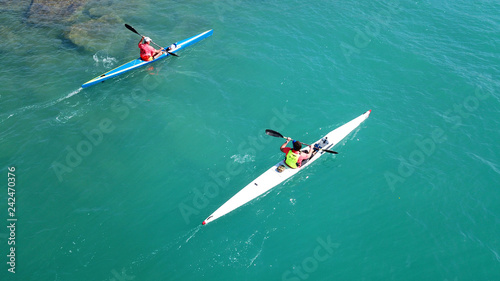 Leinwandbild Motiv Aerial drone bird's eye view of sport kayak operated a young men in tropical exotic turquoise clear ocean