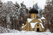 """Постер, картина, фотообои """"An old secret Orthodox church built in 1908 in a winter forest. Mysterious forest temple with a large copper dome. Unusual temple for prayer in the winter forest."""""""