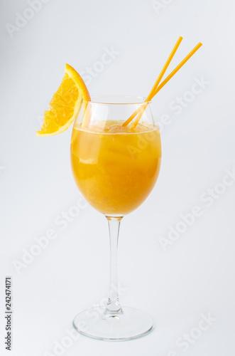 orange cocktail with orange slice on white background