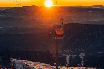 ski lift at sunset in the ski resort