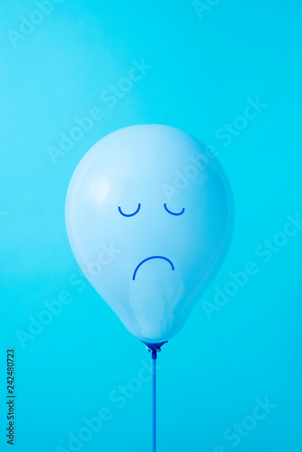 blue balloon with a sad face