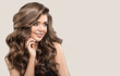 Leinwanddruck Bild - Portrait of beautiful cute woman with curly brown long hair. Gray background.
