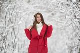 Portrait of cute happy woman outdoor. Winter forest. - 242493332
