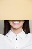 Portrait smiling woman and paper copyspace - 242493382