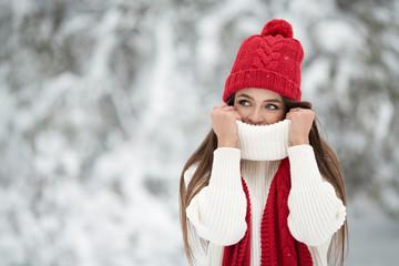 Portrait of cute happy woman outdoor. Winter forest.