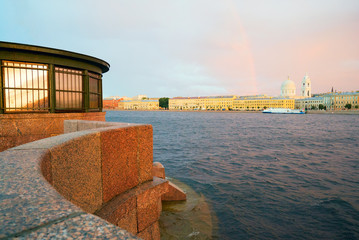 Malaya Neva, Makarova Embankment, in the evening at sunset, with a rainbow on the horizon . Saint-Petersburg.