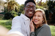 Leinwanddruck Bild - Beautiful interracial couple making a selfie