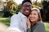 Beautiful interracial couple making a selfie