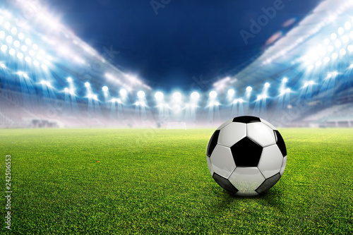 Football stadium soccer with football, lights at night 3d rendering