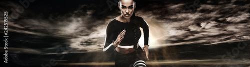 Leinwanddruck Bild Strong athletic woman sprinter, running on dark background wearing in sportswear. Fitness and sport motivation. Runner concept.