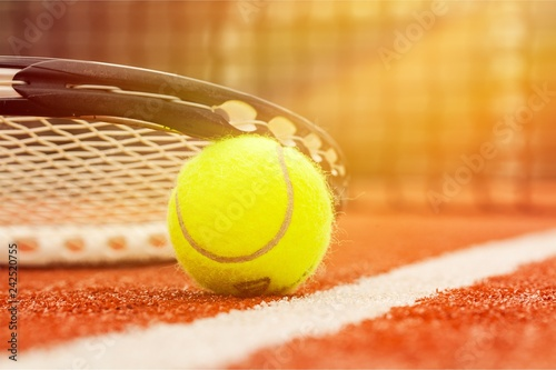 Leinwandbild Motiv Tennis game. Tennis ball and racket on court background