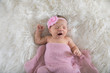 Newborn baby in pink swaddle - 242521199