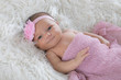 Newborn baby in pink swaddle - 242521313