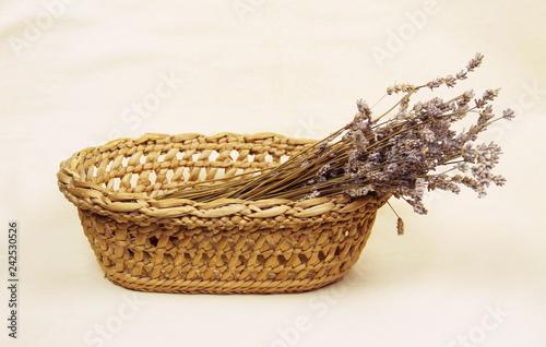 bunch of sear lavender flowers in the old wicker basket - 242530526
