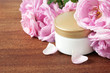 Leinwanddruck Bild - cream cosmetic and roses petals, herbal cosmetic concept