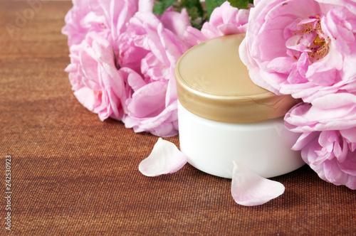 Leinwanddruck Bild cream cosmetic and roses petals, herbal cosmetic concept
