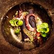 Dish with octopus and greens - 242531730
