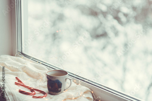 Foto Murales  tea on the window winter outside the window warmth comfort retro photo snow outside