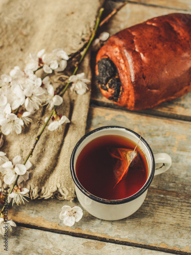 tea, hot drink (against the background of flowers). copy space
