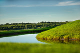 Scenic view of beautiful pond at the golf course. - 242542578