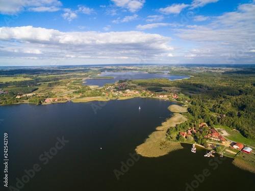 Acrylglas Pier Aerial view of beautiful Ogonki village (former Ogonken or Schwenten, East Prussia) located on Swiecajty Lake shore, Mazury, Poland