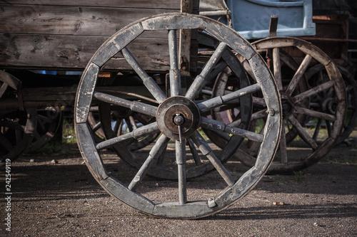 Foto Murales Wooden wheel of vintage wagon