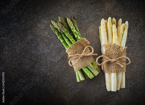 Bunches of fresh green and white asparagus