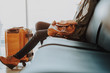 Lady is resting in airport lounge with baggage