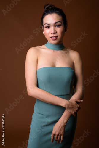Portrait of happy young Asian transgender woman smiling