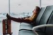 Little boy is sleeping in lobby before flight