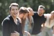 Leinwanddruck Bild - successful guy in the background of friends
