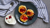 cottage cheese pancakes, tasty healthy breakfast, top view, grey stone background - 242566512