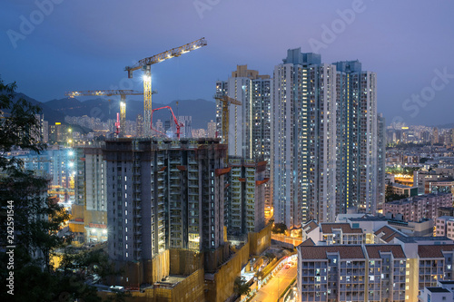 obraz PCV Building construction site in Hong Kong at night 香港のビル建築現場夜景