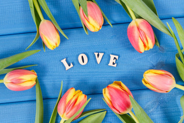 Word love and fresh tulips for different occasions