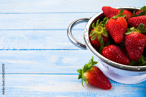 Strawberries on wooden table © Jacek Chabraszewski