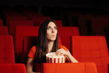 Funny Girl with Popcorn Watching Movie in Cinema Theatre - 242601366