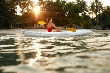 Summer Travel. Woman Kayaking In Sea Water Near Green Island © puhhha