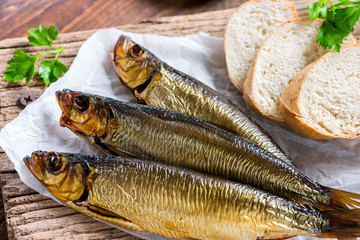 Delicious smoked salmon herring beautifully garnished on a rustic wooden table