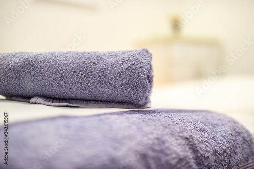 Purple towel rolled on massage table