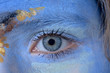 detail of eye in blue painted face